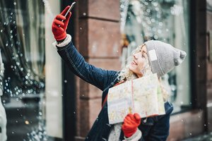 blond curly female tourist, selfie