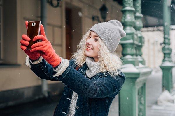 female tourist taking a selfie