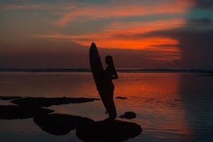 Silhouette of surfer girl