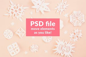Christmas paper snowflakes on pink