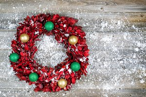 Holiday Wreath in Snow on Wood