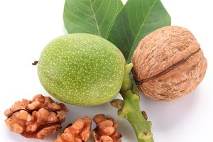 Green walnut&#x3B; peeled walnut and its kernels. Isolated on a white background.