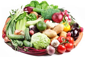 Variety of vegetables are laid out in a circle on a white background.