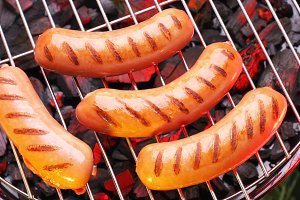 sausages in a grill