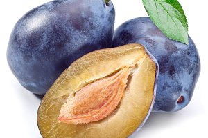 Three plums with leaf isolated