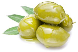 Green olives with leaves on a white background.