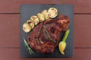 Rib-eye steak on black slate plate