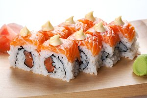 Salmon sushi rolls on a plate.