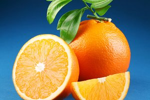Ripe orange on a blue background