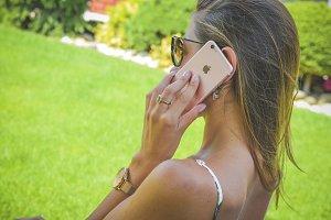 Busy woman calling at garden