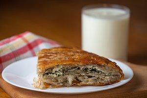 Serbian burek pie served with yogurt
