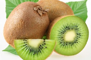 Kiwi with leaves on a white background