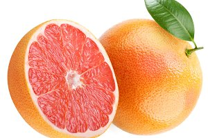 Ripe grapefruit with leaf and half of fruit. Isolated on a white.
