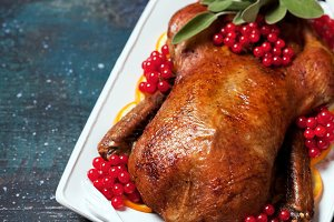 Roast duck with oranges, sage and berries