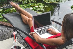 Woman working at lounger #2