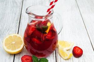 Jug of lemonade with strawberries