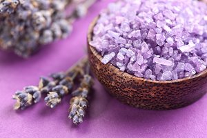 Sea-salt and dried lavender on a violet background.