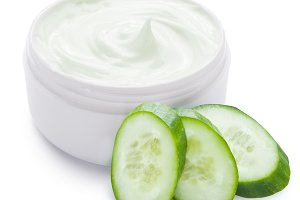 cream and slices of cucumber