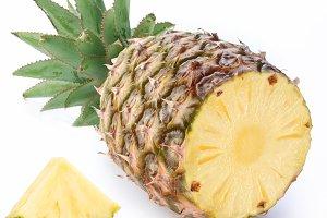 Cut ripe pineapple with rich green rosette. Isolated on a white.