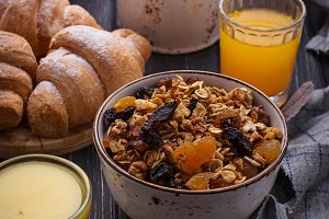 Breakfast with granola and croissant