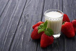 Strawberries and glass of milk