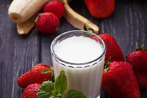 Strawberries and glass of milk