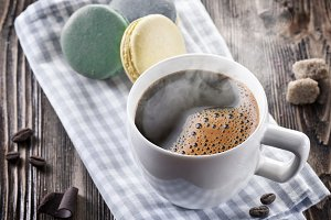 Cup of coffee and french macaron