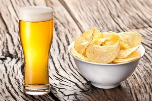 Potato chips  and glass of beer