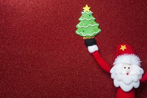 Santa and cute tree on red glitter