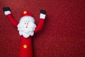 Santa on red glitter background .