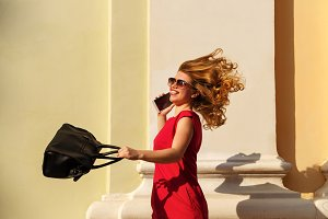 Girl with trendy handbag and phone