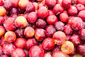 Red ripe plums at the market