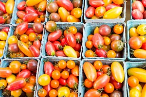 Fresh cherry tomatoes in baskets