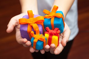 Hands with gifts