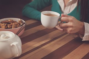 Woman is drinking a cup of coffe