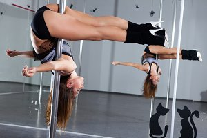 Woman in a suit for the pole-dance