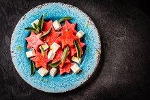 Mediterranean watermelon, feta cheese and mint salad on blue plate.