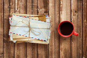 Pile of old envelopes and coffee cup