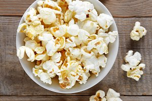 Popcorn close-up on wooden table