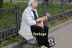 Yard play musician -balalaika