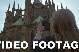 Woman tourist taking mobile photo