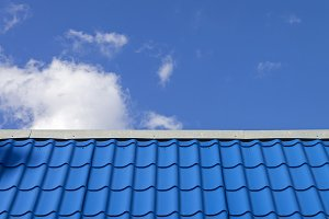 Blue roof against the blue sky.