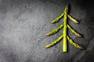 Food background. Christmas tree made from asparagus Healthy holiday concept