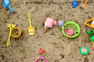 plastic toys in humid sand