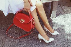 Vogue woman with red handbag