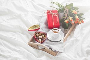 Holiday concept with flowers, coffee