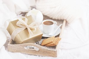 Holiday concept with gift and coffee
