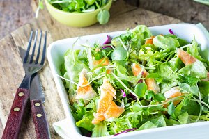 Chicken caesar salad with lettuce and arrugula