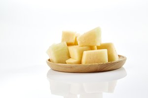 melon slice on wooden plate