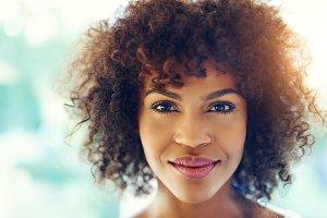 Pretty black girl smiling at camera
